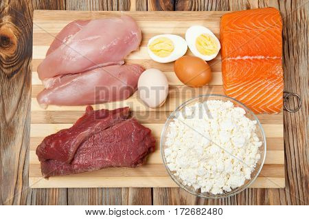 Protein Diet, Fish, Cheese, Eggs, Meat And Chicken On A Wooden Background