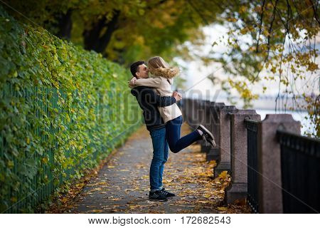 A Young Guy Met His Girlfriend And Raised His Hands. Romantic Mood