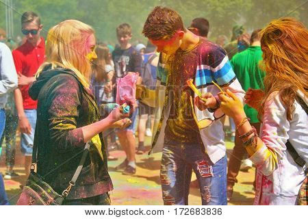 TULA RUSSIA - JUNE 13 2016: Young people throw each other colored paint at festival of colors Holi on June 13 2016 in Tula Russia