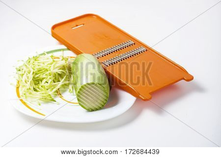 Grater And Grated Zucchini.