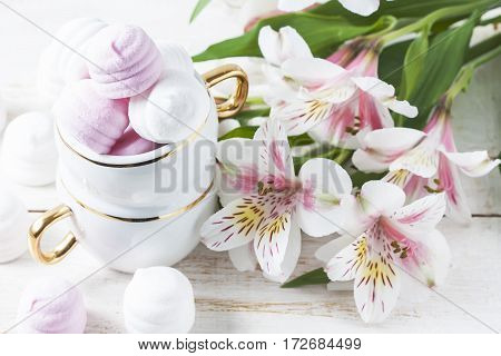 Delicious white and pink marshmallows in cup. Selective focus