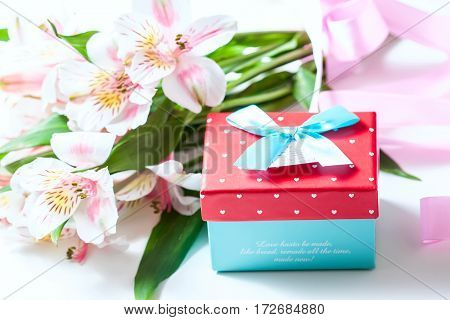 Bouquet Of Flowers Alstroemeria With Gift Box On A White Background.