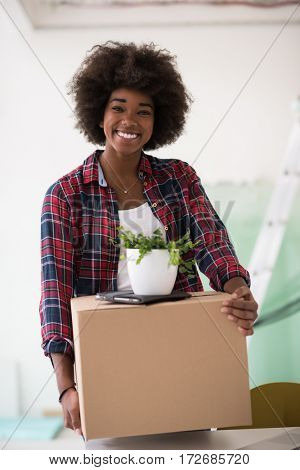 Beautiful African  American girl moving in the new apartment