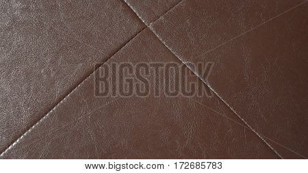 Brown leatherette texture for background, Close up the top view.