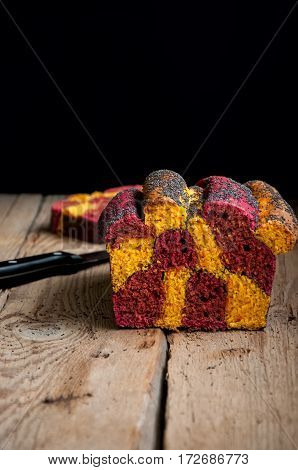 Carrot and beetroot bread with poppy seeds on a wooden table