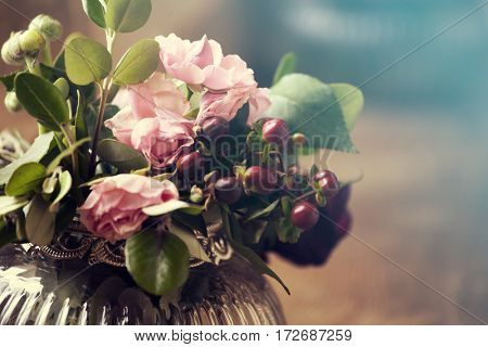 Close up on pink roses in antique pot
