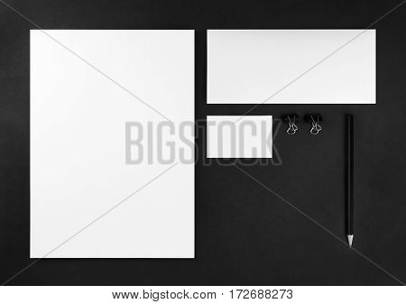 Photo of blank stationery set for placing your design. Corporate identity template on black background. Mockup for branding identity. Top view.