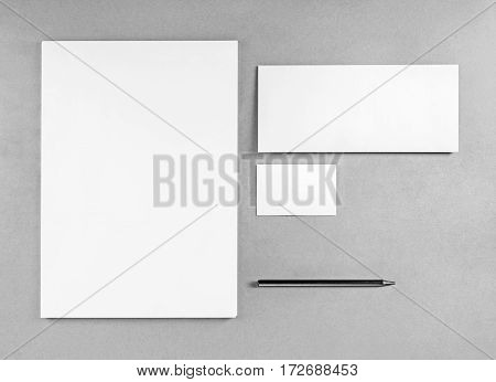 Blank stationery template for placing your design. Photo of blank stationery set. Blank letterhead business cards envelope and pencil. Mockup for branding identity. Top view. Grayscale image.
