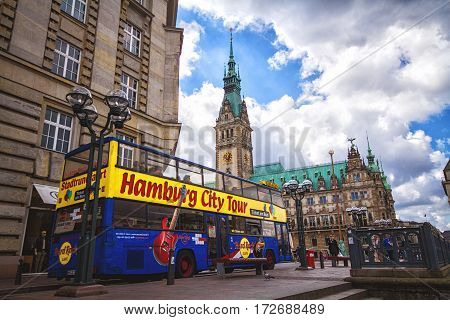 HAMBURG GERMANY - JUNE 10: Exterior view of the town hall of Hamburg and touristic bus in 2012. The town hall German The Hamburg Rathaus was built 1897 and is the seat of the government of Hamburg