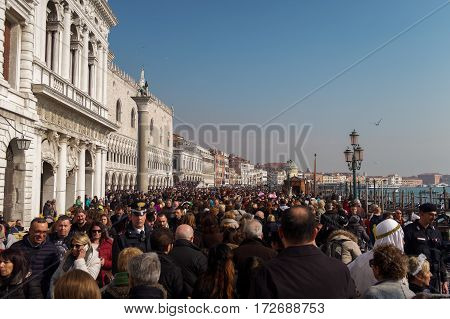 Venice, Italy - February 19 2017: Police security control for Venice Carnival. Italian police carabinieri checks crowds ready to enter the main area of celebrations for the Venice 2017 Carnival.