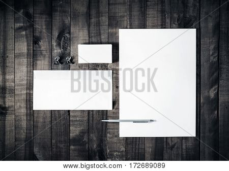 Blank stationery set on wooden table background. Blank letterhead business cards envelope and pen. ID template. Mockup for branding identity. Blank letterhead business card envelope and pen. Top view.