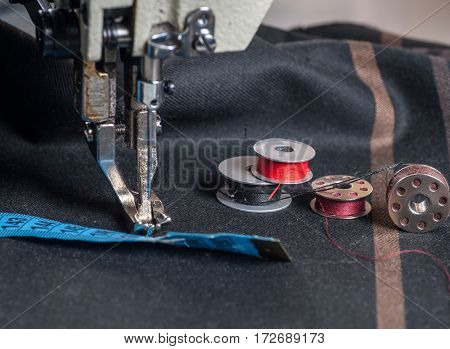 Close shot of an industrial sewing machine