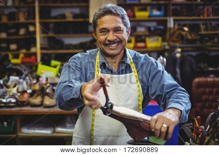 Shoemaker repairing a shoe in workshop