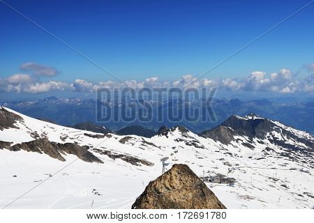 snow capped mountain peaks and blue sky