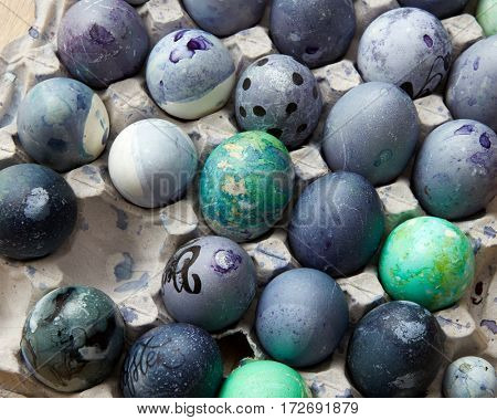 painted blue eggs in the tray