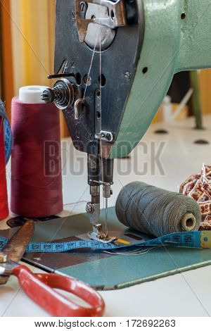 Old sewing industrial mashine in tailor shop