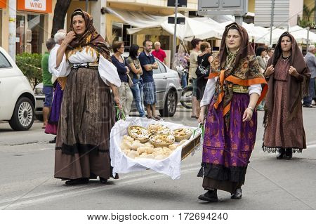 QUARTU S.E., ITALY - September 15, 2013: Wine Festival in honor of the celebration of St. Helena - folk group of Guspini - Sardinia
