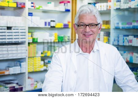 Portrait of pharmacist in lab coat at pharmacy
