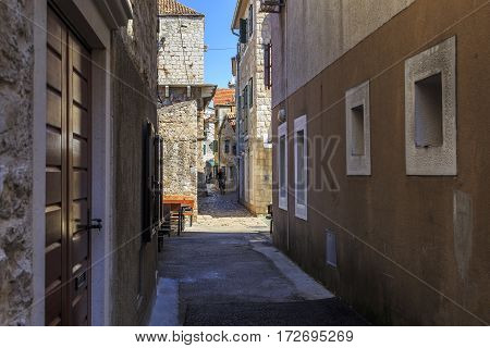 VODIVE, CROATIA - SEPTEMBER 6, 2016: This is one of the streets of the old historic part of the small Croatian seaside town.