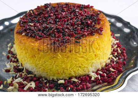 Traditional Iranian Rice Pie Tahdig Polo with Berberis on a tray