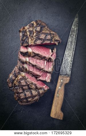 Barbecue dry aged Wagyu Entrecote Steak as close-up on a slate