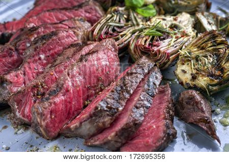Barbecue Wagyu Point Steak with Artichokes on Plate