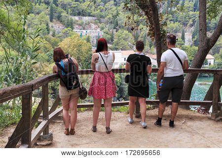 SKRADIN, CROATIA - SEPTEMBER 9. 2016: Unidentified tourists are on the viewing platform above the waterfall of Skradin Buk in Krka National Nature Reserve.
