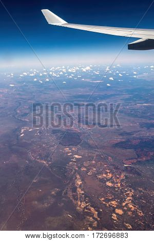 Flying above the Australian outback. Atmospheric haze and internal reflections make for a challenging shooting condition.