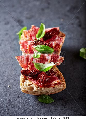 Mediterranean-style ciabatta sandwich with salami and dried tomatoes