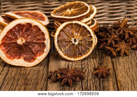 Star anise oranges and grapefruit on the old wooden table. Selective focus.