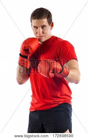 Portrait Of Young Boxer Making Punch Isolated On White Background
