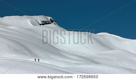 Three skiers doing a ski tour in the bavarian alps