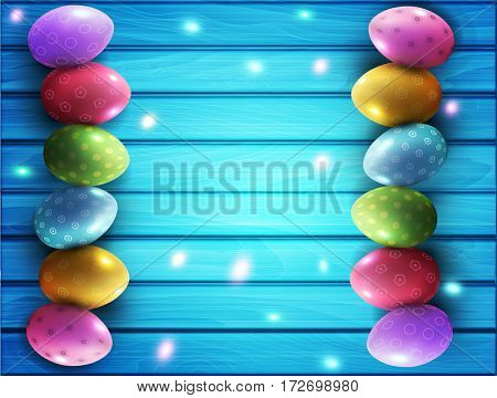 background for Easter. Colored eggs lying on a blue wooden board