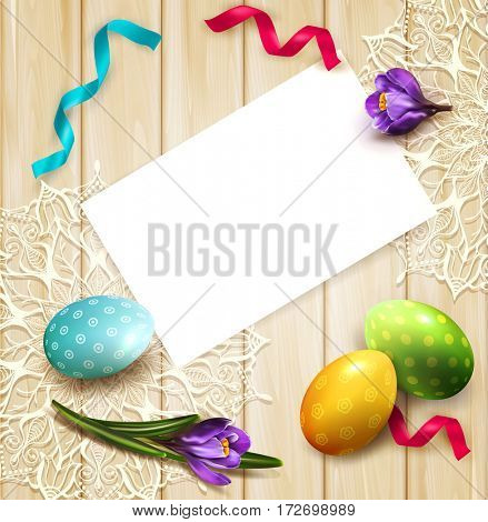 festive background with Easter eggs and crocuses card lying on a wooden table. View from above.