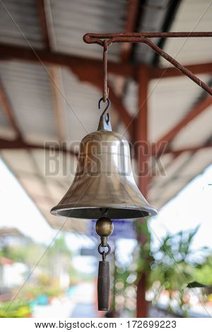 Shiny bell used to signal the train station