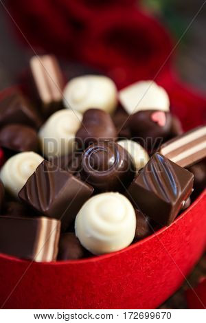 chocolate pralines in heart shaped gift box background- Mother's Day