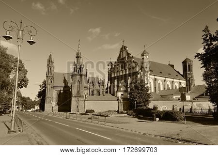 St Anne's and Bernardinu church in Vilnius Old Town, Lithuania, Sepia toned photo.