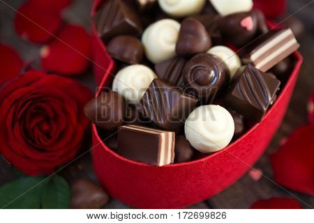 Chocolate pralines in gift box on wooden for Mother's Day background