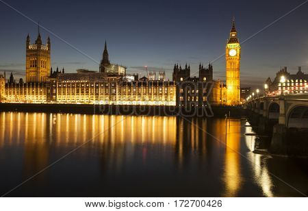Big Ben and House of Parliament at Night with reflection in Thames river, London, United Kingdom