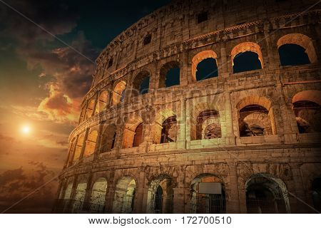 Rome, Italy. One of the most popular place in world at evening - illuminated Roman Coliseum  under dark sky.