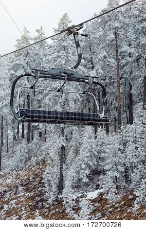mountains with modern ski lift chair in winter