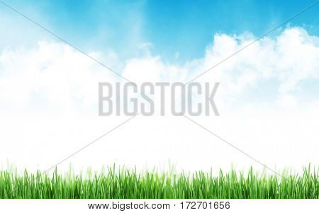 Abstract sunny spring background with grass and cloudy sky