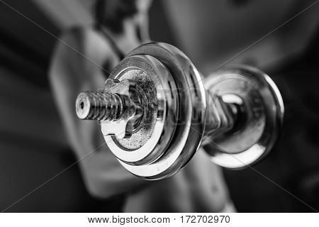 Woman Exercising With Weights In The Gym