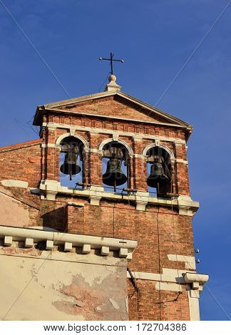 Sant Maria del Giglio charcteristic belfry with three bells in Venice