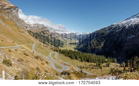 A valley and moutains, with a winding road in the foreground. Taken at Klausenpass, Switzerland