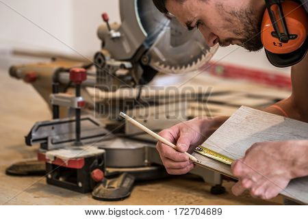 A Man Working With A Miter Saw