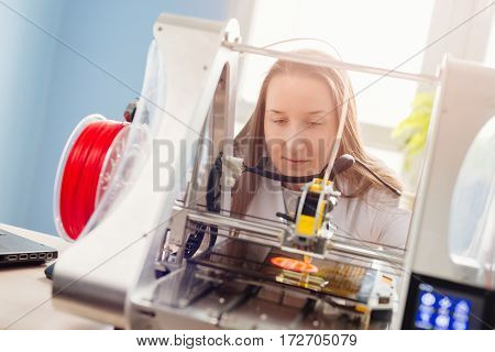 Woman Working With 3D Printer