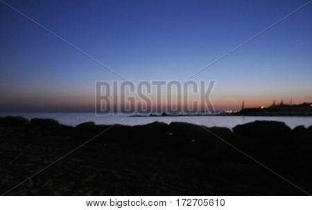 blurred background. sunset on the beach. twilight. the horizon line