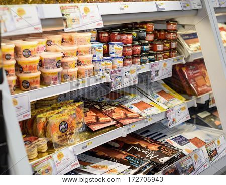 PARIS FRANCE - DEC 21 2016: Large selection of French delicatessen - fish eggs red roe red caviar baked salmon in Simply supermarket - part auf Auchan