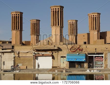 YAZD, IRAN - OCTOBER 9, 2016: Traditional water reservoir on sunset on October 9, 2016 in Yazd, Iran, Asia